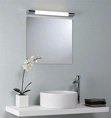Bathroom Light Fixtures Above Mirror by Above The Mirror Lighting How To Light Up Your Bathroom