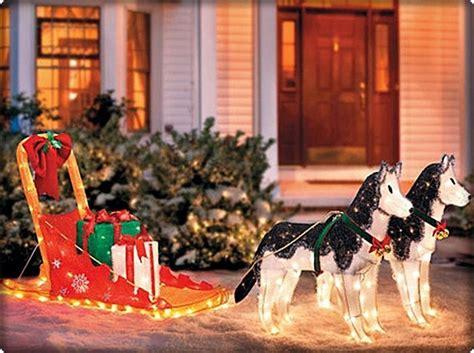artic scene  siberian huskies pulling sled lighted