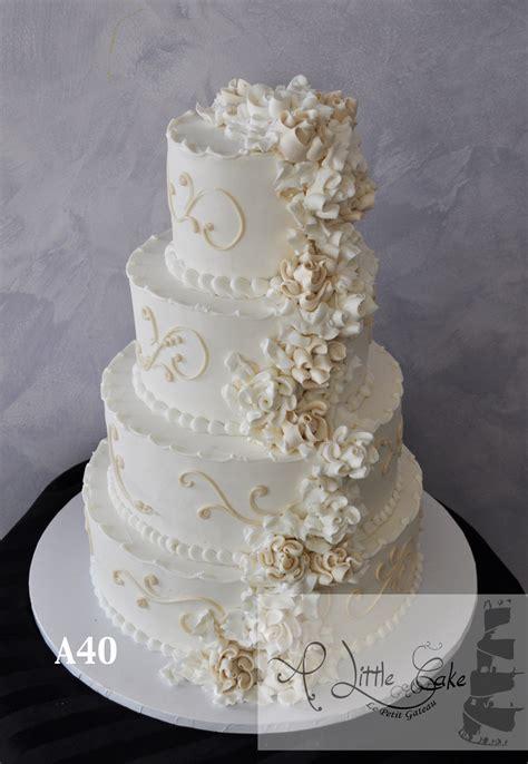 elegant gold  white floral buttercream wedding cake