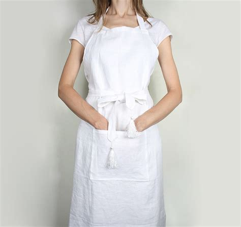 what is an apron white linen apron with tassles