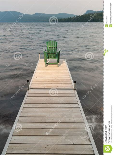adirondack chair on a wooden dock stock photos image