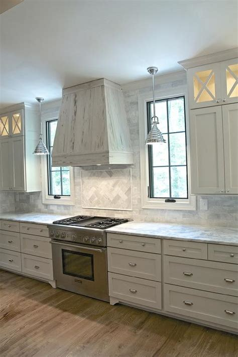 white kitchen cabinets  gray framed glass doors