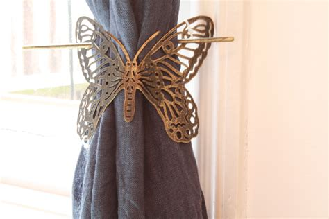 1x brushed gold black butterfly design metal curtain tie
