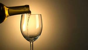 White Wine Is Poured Into Glass With Space For Copy Stock ...