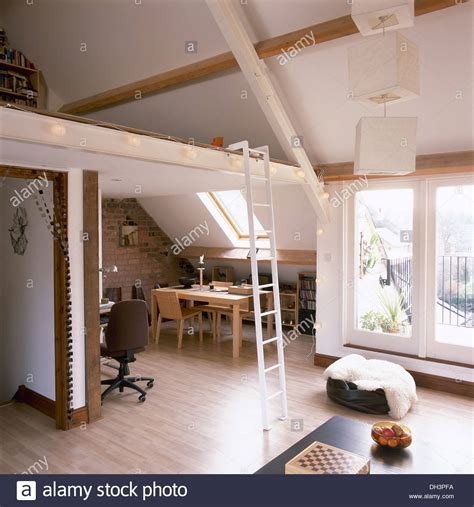 pale wood dining table  chairs  small loft conversion  stock photo  alamy
