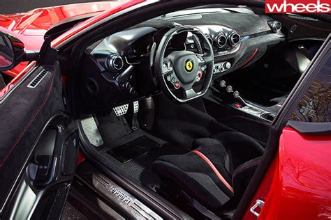 Watch cars being assembled in our ferrari factory tour. 2016 Ferrari F12 tdf review