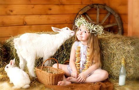 image  girls goat rabbit children wicker basket hay