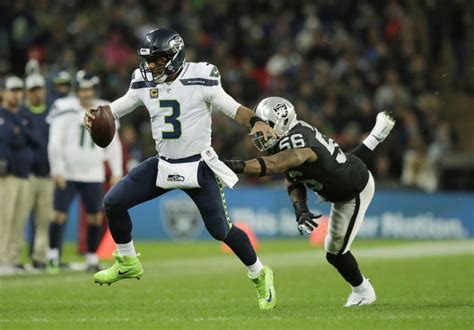 seahawks roll  london victory  raiders