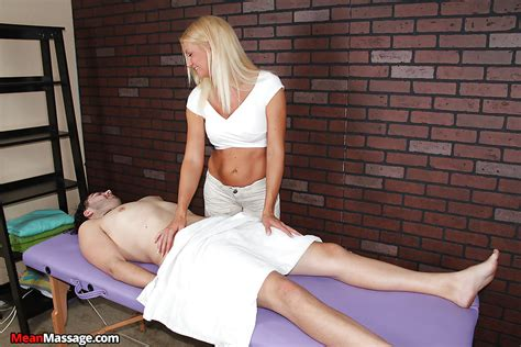 Fully Clothed Blonde Massagist Giving A Handjob To