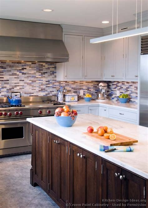 transitional kitchen design with pale blue shaker style cabinets