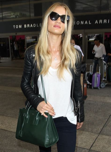 rosie huntington whiteley carries saint laurent