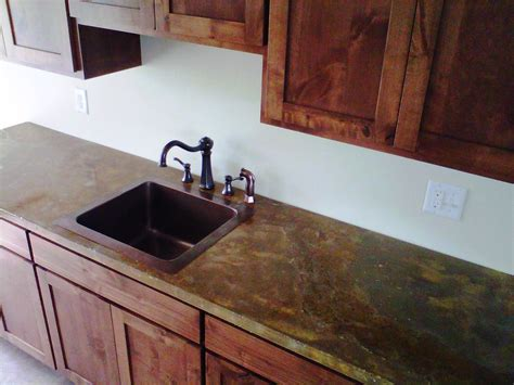 brown granite countertop and square brown sink also