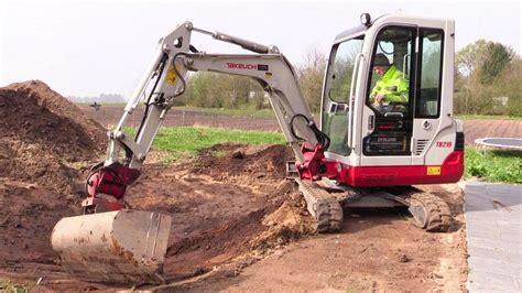 digging  takeuchi tb mini excavator youtube