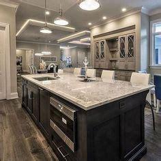 blue cabinets in kitchen giallo ornamental granite countertops add elegance in the 4802