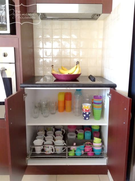 Kitchen storage idea for cups and drink bottles cupboard