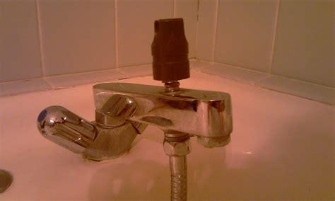 demonter un ancien robinet melangeur bain douche
