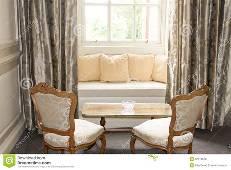 window chairs window seat and drapes stock photo image of windowed 32211576