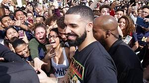 Hip-hop star Drake surprises Miami students, films video at...