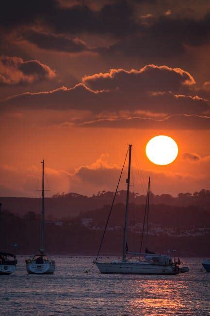 boats sailing  sea  sunset  stock photo