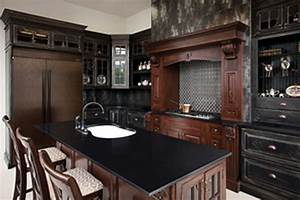 FURNITURE: Black Corian Countertop With Arch Faucet And
