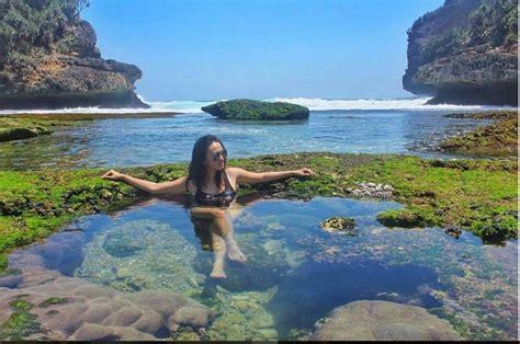 wisata kolam renang alami pantai batu bengkung merahputih