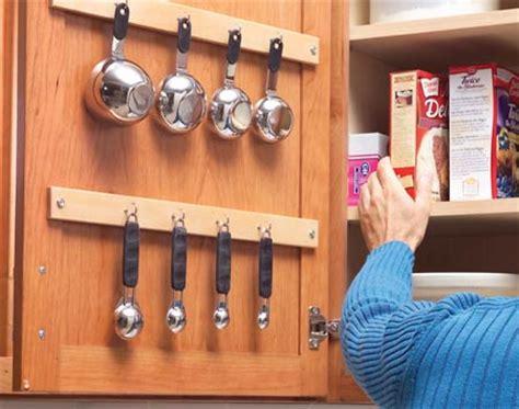 inside kitchen cabinet door storage 5 space saving solutions to mount inside kitchen cabinet 7531