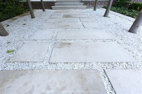 White Paving Stones by A Garden Pathway Made Form Square Cut Limestone Stepping