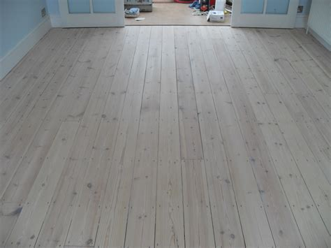 Lovely White Wood Flooring  Home Design #1038. Modern Bathroom Decor. Bedroom Floor Lamps. Black Metal Roof. Us Buildings. Grey Siding. Gray Stained Wood Floors. The Arrangement Dallas. Bar Stools With Backs