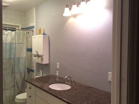 over bathroom sink lighting need help center a bathroom light over sink or cabinet