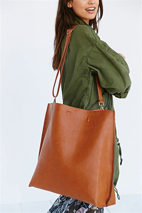 lyst urban outfitters oversized reversible vegan leather tote bag  brown
