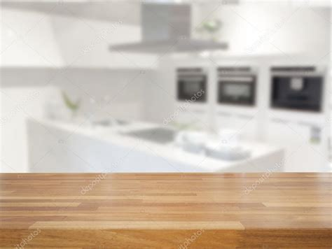 kitchen table background free hd empty wooden table and blurred kitchen background stock