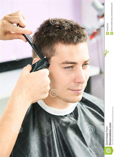 Mens Hair Dresser male hairdresser at work stock photo image of mirror