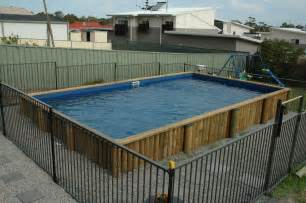 Pool Decks Plans Inspiration by Favored Aboveground Rectangular Pool With Iron Fences And