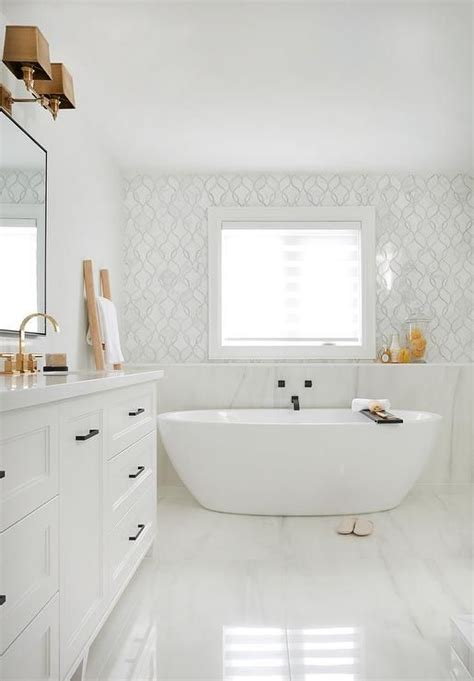 Bathroom Window Ledge by Freestanding Oval Tub A Window Framed By White And