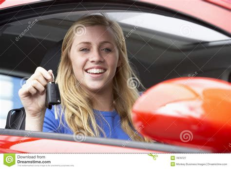 Teenage Girl Sitting In Car, Holding Car Keys Stock