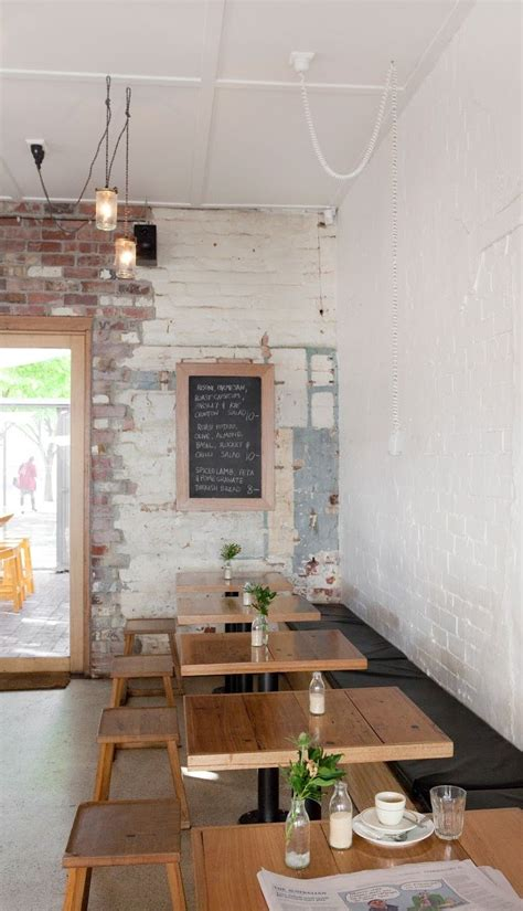 industrial exposed brick industrial light fittings and simple wooden furniture wee jeanie
