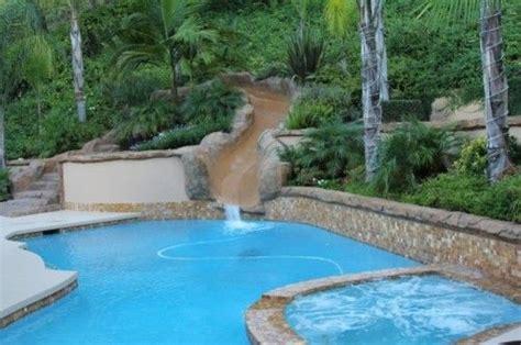 pool slideretaining wall   hill  yard