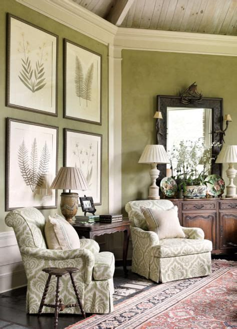 Muted lime green living room with damask chair and framed