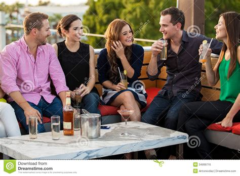 young adults having drinks at a bar image of