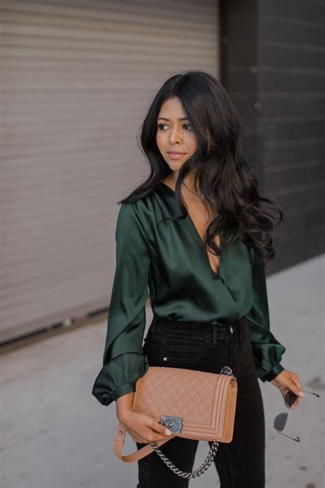 plunging neckline blouse picture of black skinnies and a green blouse with a