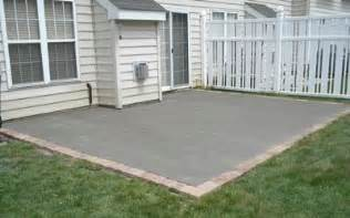 bricks around outside of cement patio a simple add on at