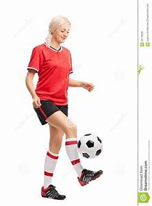 Female Soccer Player Juggling A Ball And Smiling Stock ...