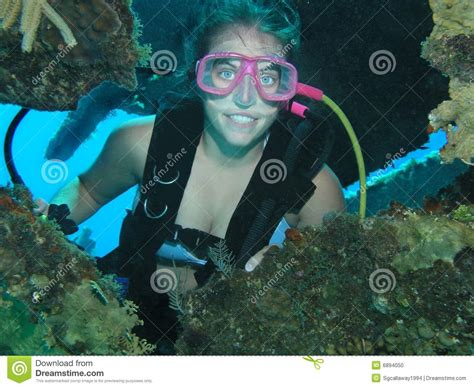 Female scuba diver stock photo. Image of goggles, below