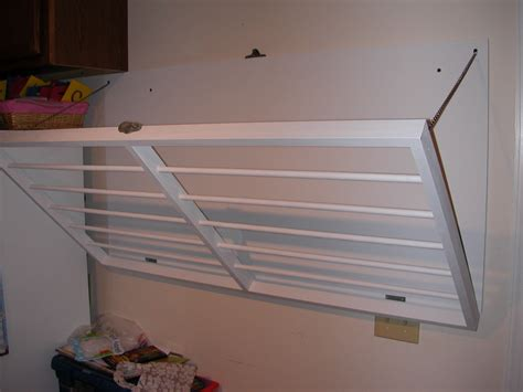 wall mounted laundry drying rack with simple white wall