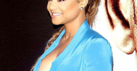Christina Milian Flashes Sticky Tape In Plunging Top