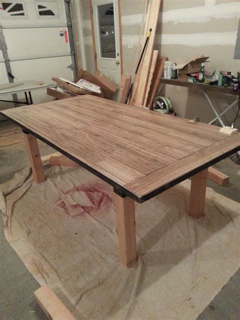 Table Within A Table by Diy Dining Table Laminate Flooring As The Table Top
