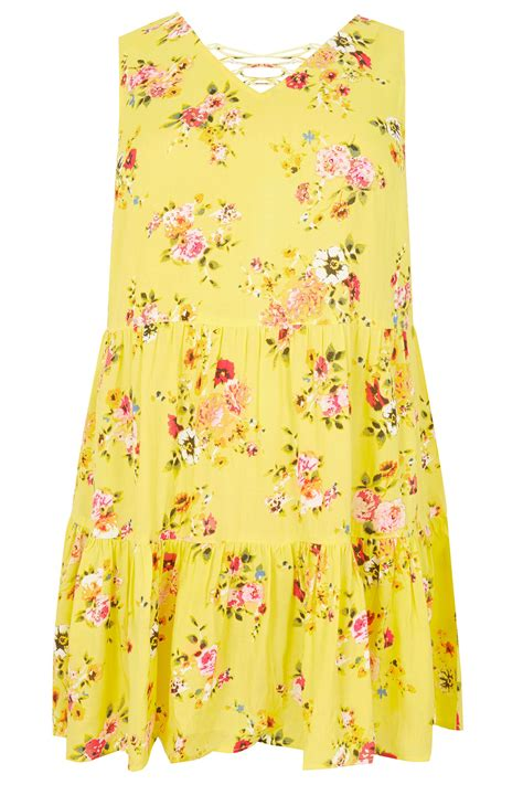 floral cross forms yellow floral layered longline top with front lace cross