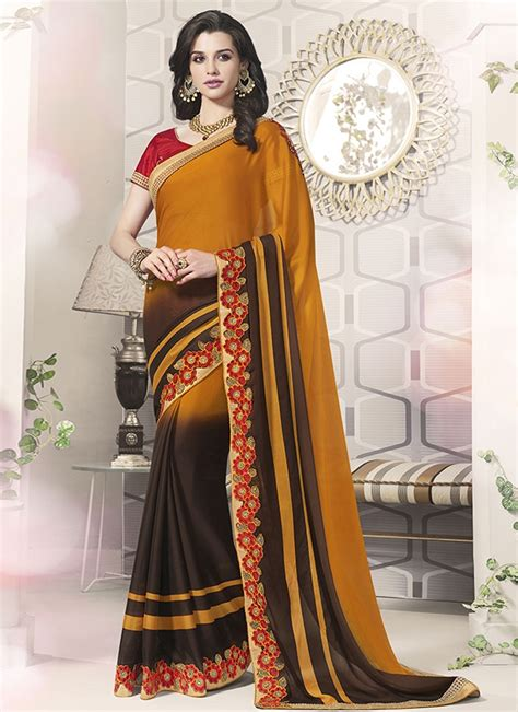 The common rule is that lighter shades are teamed with dark colored blouses, while darker shades go well with light hues. Renowned Coffee Brown And Mustard Color Party Wear Saree