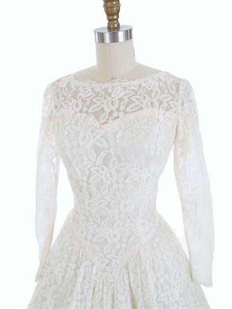 white long sleeve lace tea length wedding dress