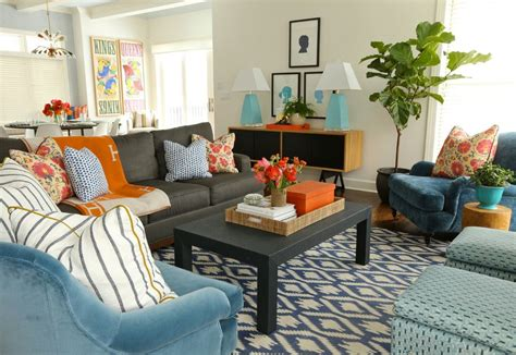 In the living room of a long island home renovated by designer daniel sachs and architect kevin lindores. Burnt orange and blue decor living room contemporary with ...